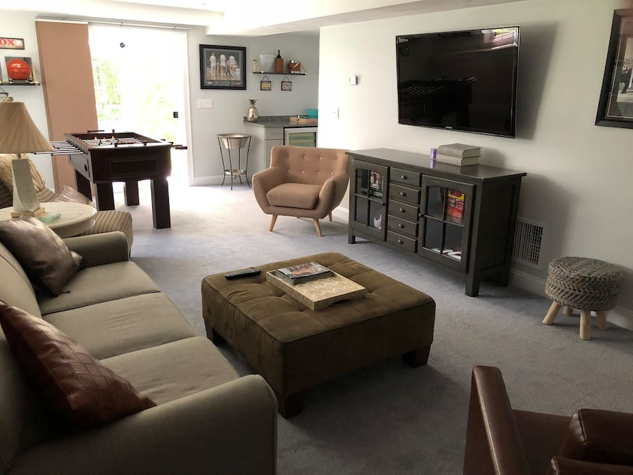 Game room with full power queen air mattress in coach, foosball table, HDTV, beverage center, full bath, walk out patio
