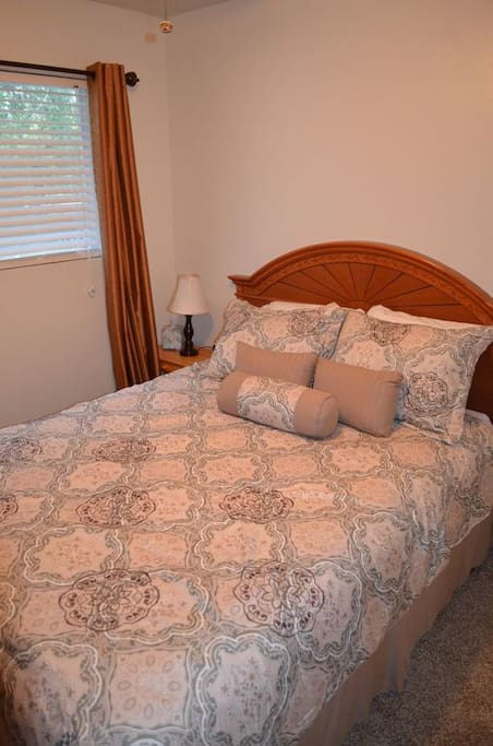 Queen bedroom with comfy bed.