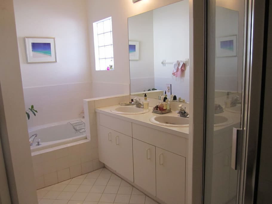 Large Bathroom with bath and shower.