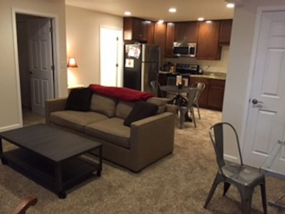 Living room and fully equipped kitchen. Bathroom and bedroom are to the left.