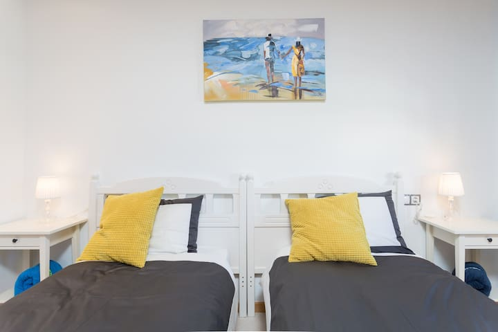 twin beds of the 1st bedroom