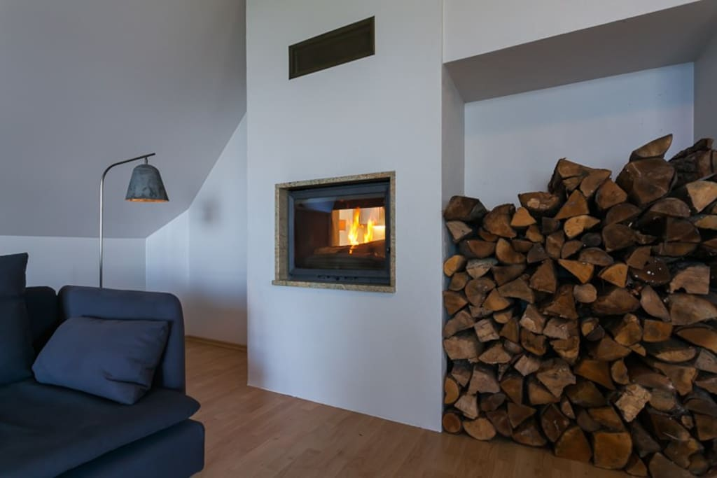Double-sided fireplace with all the logs you'd want.