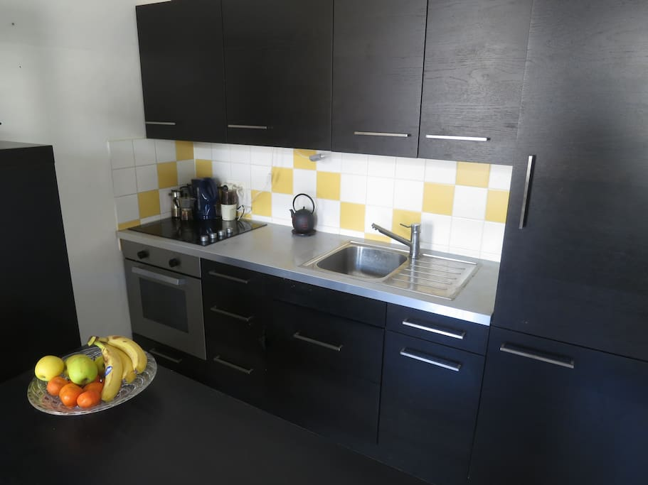 The fully equipped kitchen is ready to be used.