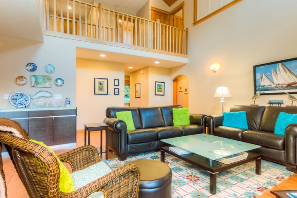 Kick back in the living room with plenty of comfortable seats to choose from
