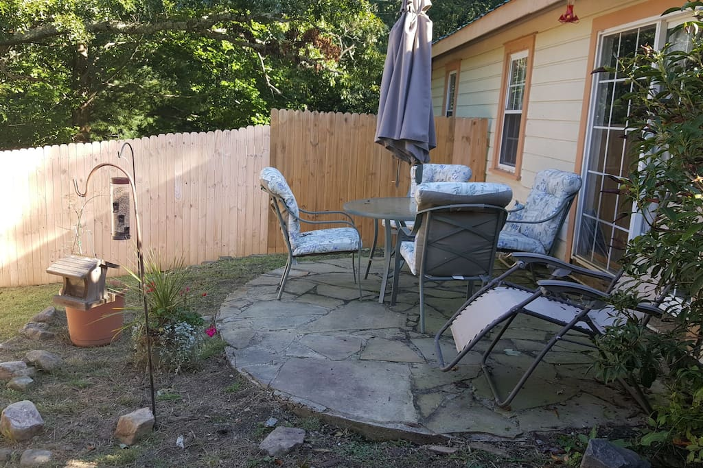 Outside of the kitchen is an enclosed patio
