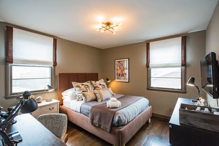 "Guest Bedroom with Luxury Bedding, Desk, 54"" TV and plenty of storage"