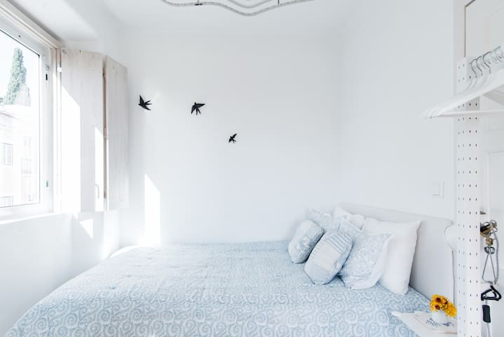 """This bright bedroom connects as an """"open space"""" to the living room and the balcony"""