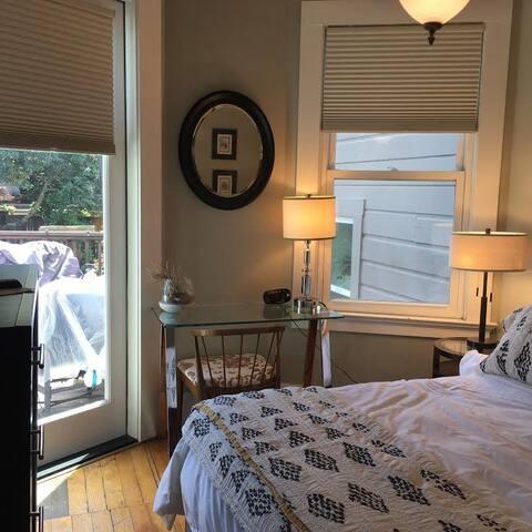 Quiet private bedroom facing deck and garden with desk