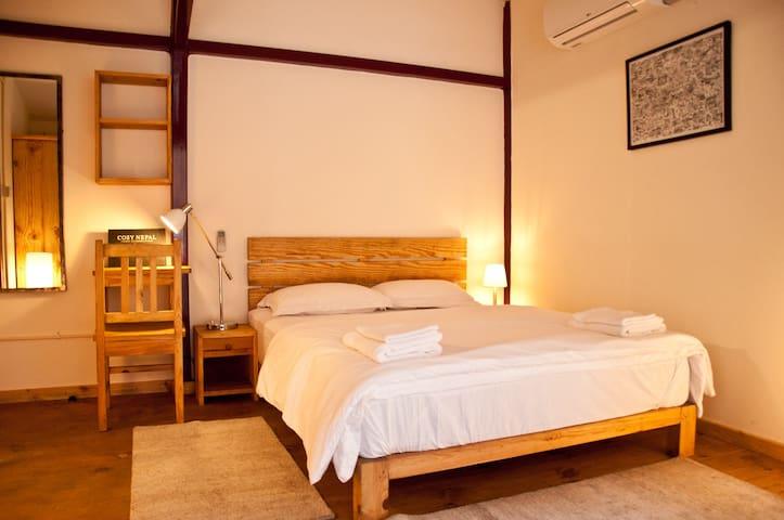Zen bedroom with queen size bed.