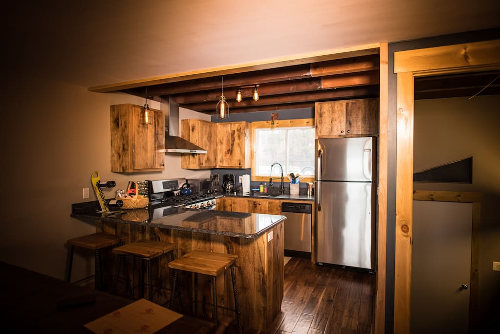 Main floor has great open concept kitchen and bar