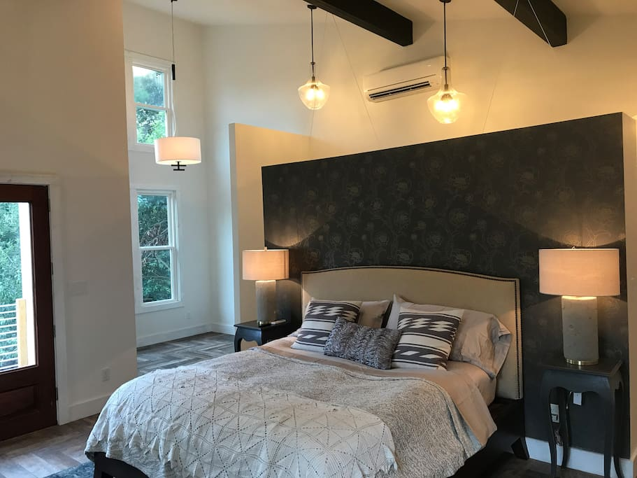 Master Bedroom with King bed and a room to side that will fit a Queen Air Mattress