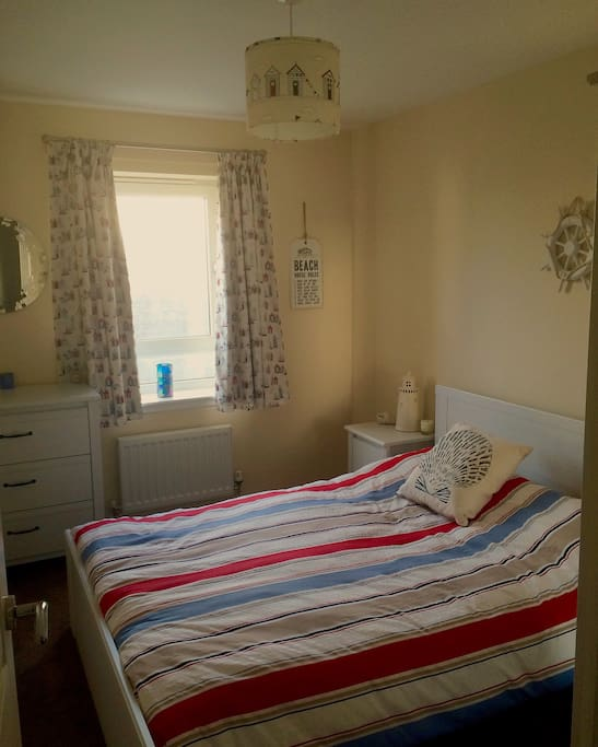 Lovely beach themed double room with chest of drawers, wardrobe and bed side cabinet. You can even see Edinburgh Castle way in the distance from your window!
