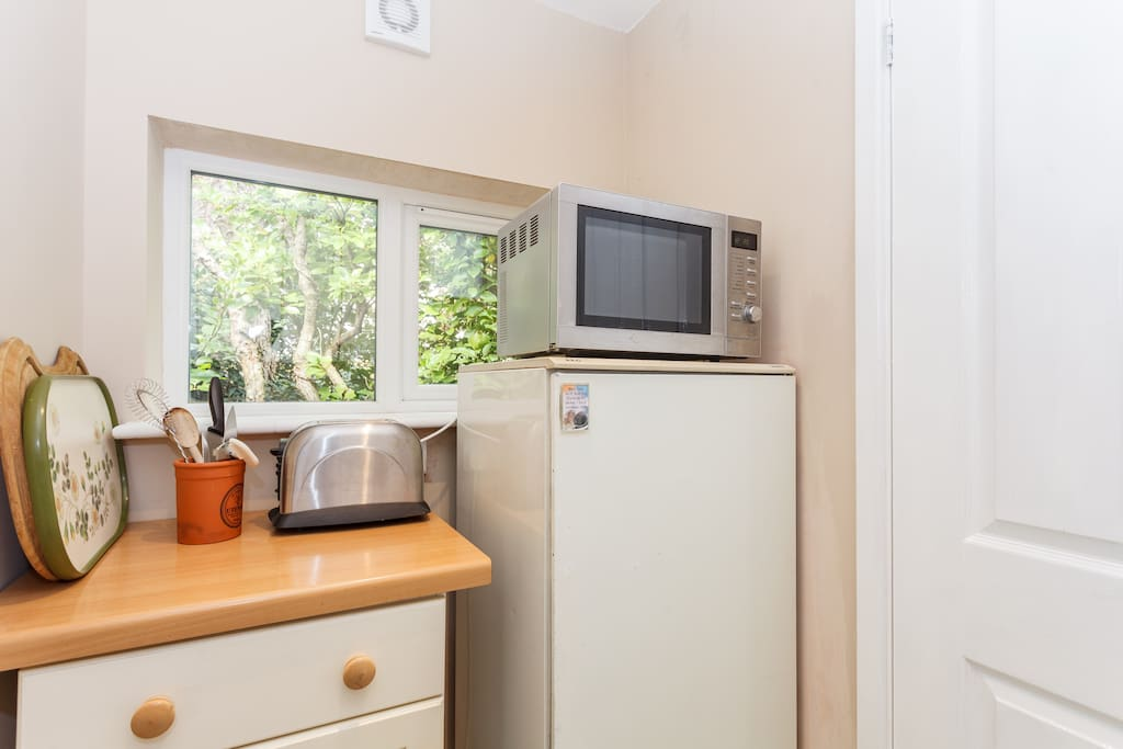 Simple meal preparation and fridge space in our utility area.