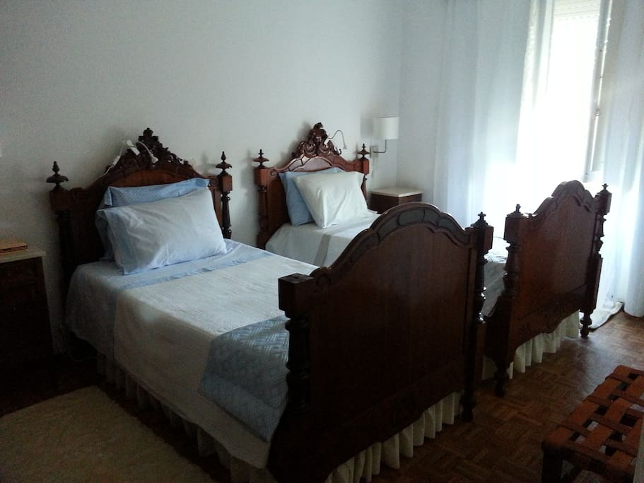 The twin room with it's antique beds.