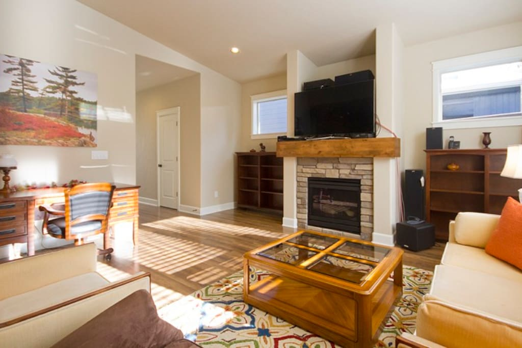 Large open social lower level with hardwood floors throughout.  Living room is furnished with a large flat screen LCD television, basic cable and DVD