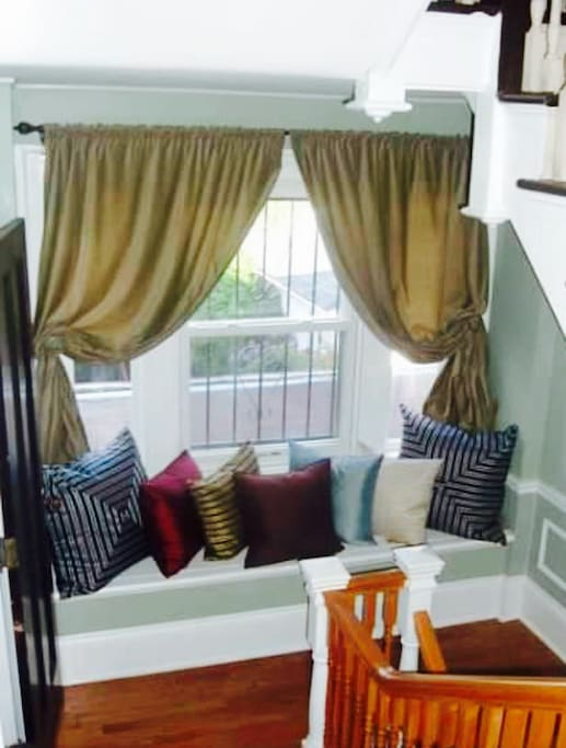 Cozy window seat for relaxing with morning coffee, evening glass of wine, and a great book.