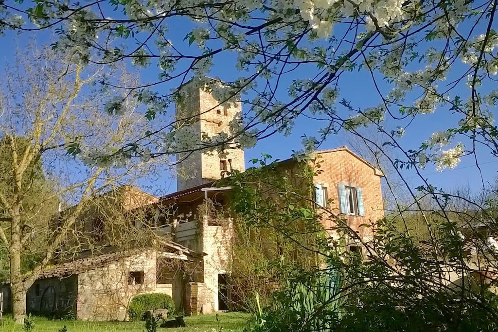 Ancient Building with a very picturesque exterior, beautiful garden in a  river valley