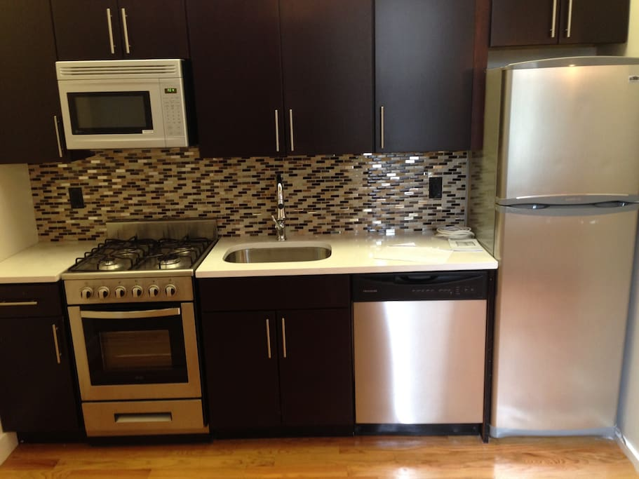 brand new kitchen with stainless steel appliances (including a dishwasher)!