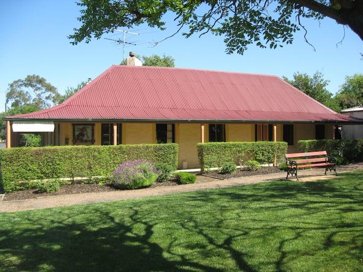 Goat Square Cottages - historic Menge Cottage
