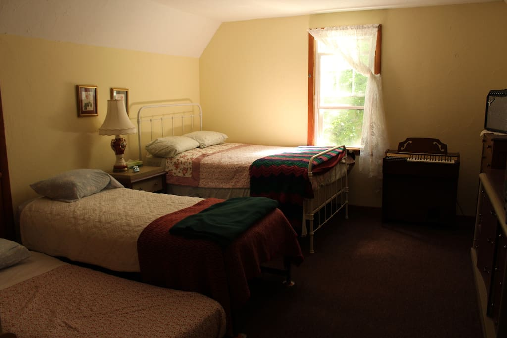 Quiet private upstairs room with double bed, single bed and trundle bed.