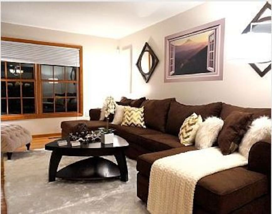 Great Room features sectional pullout sofa, chaise, and designer details