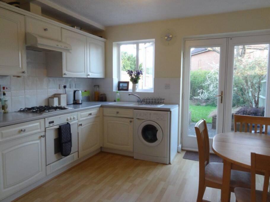 clean spacious kitchen leading to garden