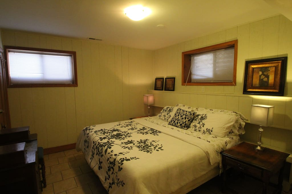 King Bedroom with Antique Dresser and Large Closet for Storage along with Hanging Clothing.