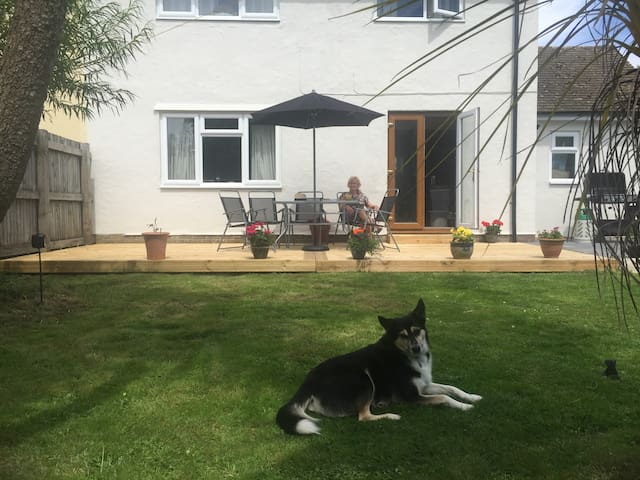Pet friendly well kept lawn and broad decking to admire the garden.