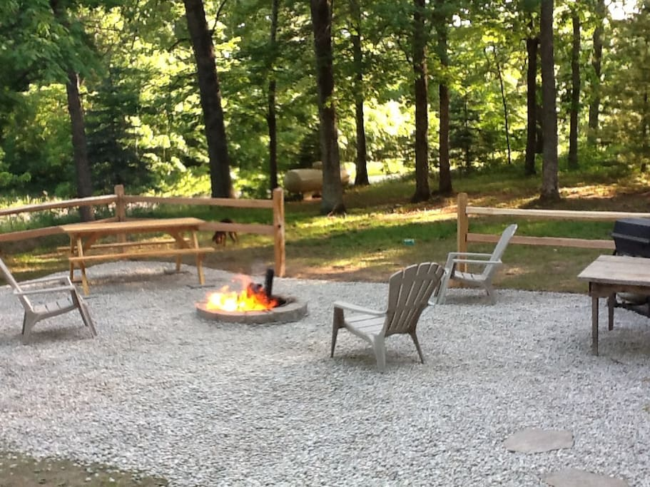 Awesome firepit  area with grill and picnic table.