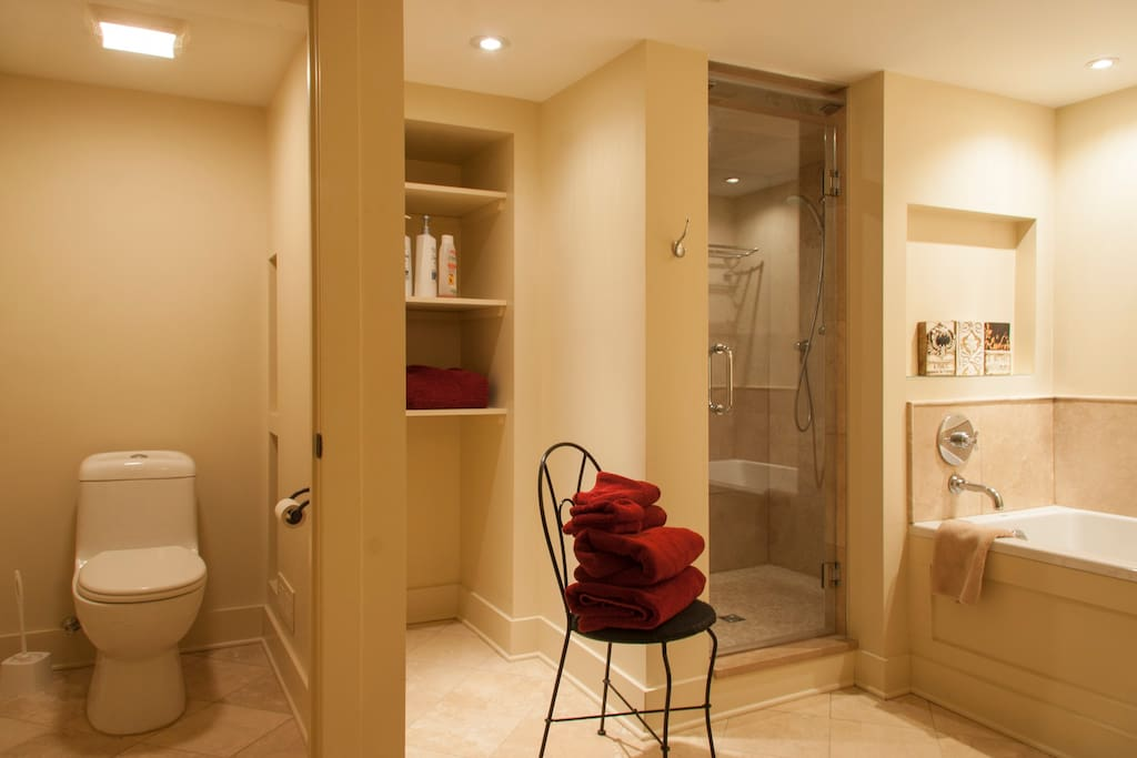 Spacious and clean bathroom.  We provide the towels and shampoo.