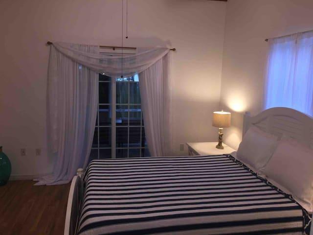 2nd bedroom w private screened in rear porch, walk in closet & en-suite full bathroom