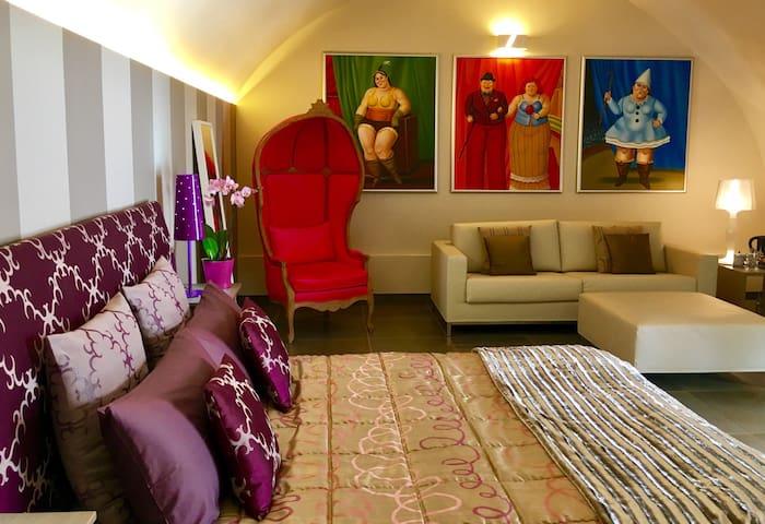 Suite Botero, con portico