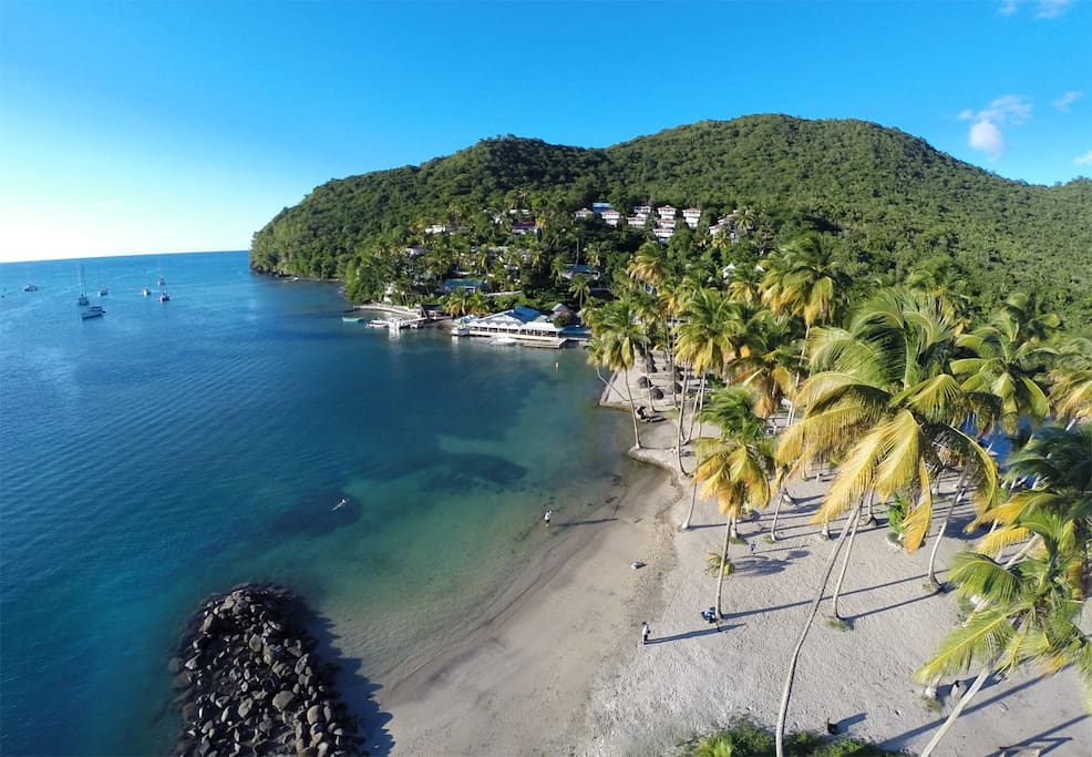 Located just up the hillside above the beach..