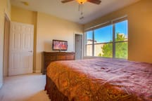Master suite with a king bed