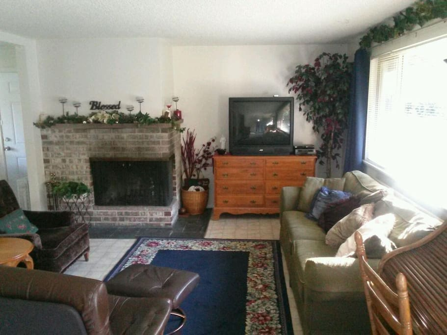 Comfortable! Fireplace works great! Kitchen with full sized refrigerator to left.
