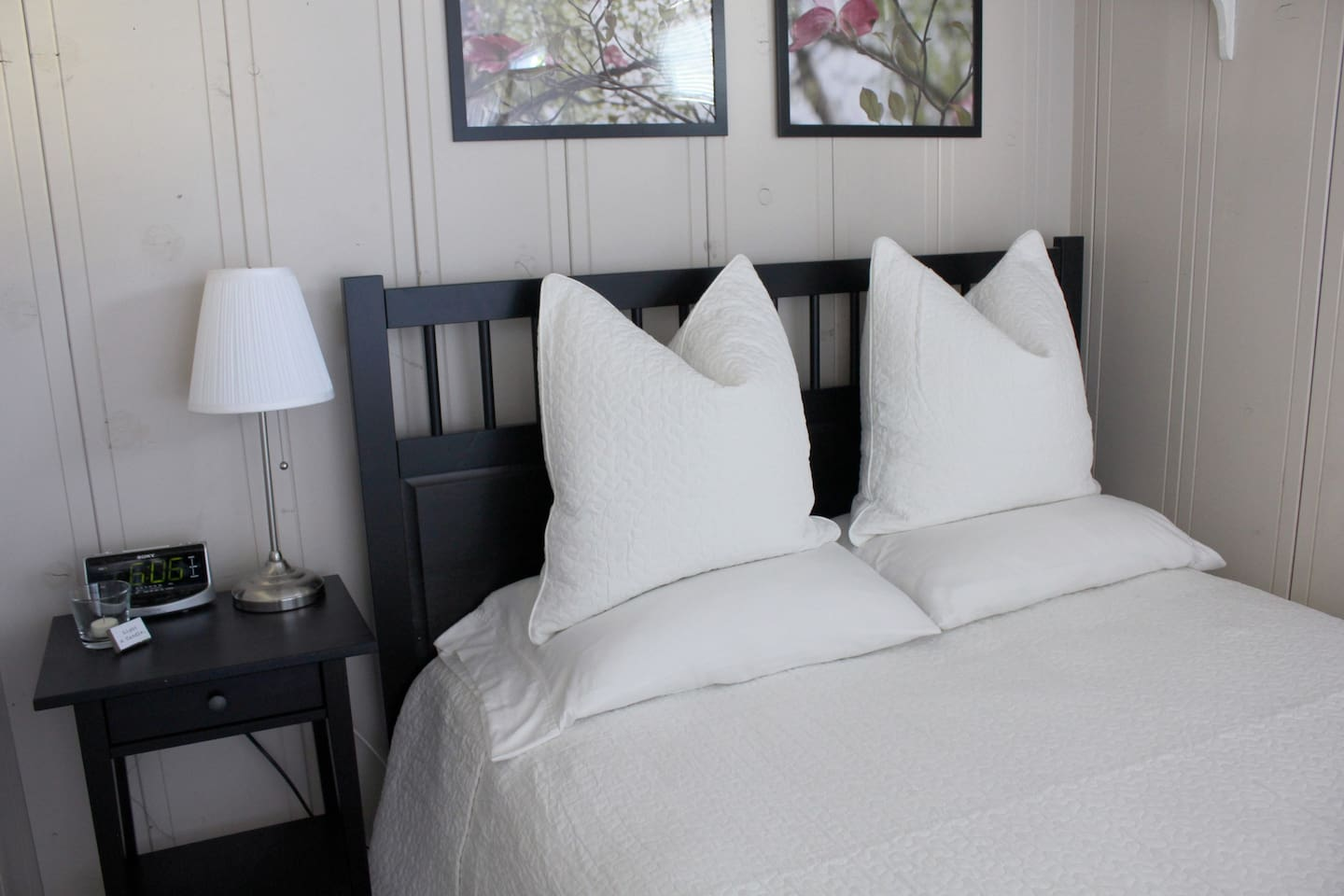 """The Cottage   Snuggle up in the queen-size bed w/ 3"""" memory foam mattress topper and cozy linens."""