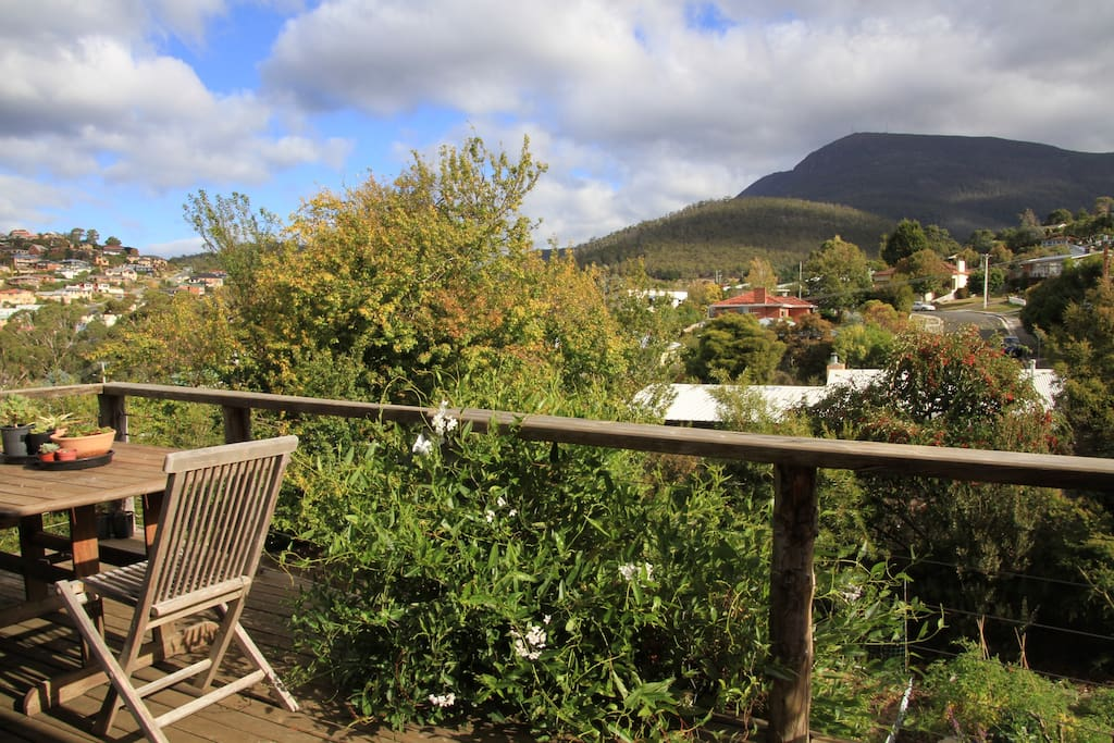 Our deck off the  living room and view of Mt Wellington: the  perfect spot to catch the afternoon sun and sunsets!