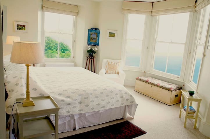 Bedroom 2 with a bed which  can be double or twin has a view over the pool toward Mousehole and from the bay window sweeping views out to sea