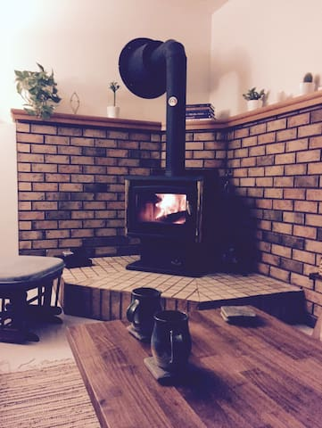 Cozy wood stove for those chilly days. Guaranteed you will love this bonus in the winter. Wood included. If your lucky it might even be going for you when you return home:)