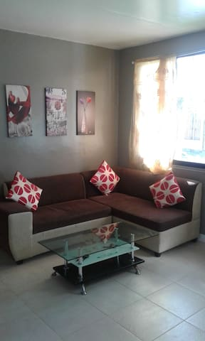Relax with a glass of wine and watch a movie on this Front Living Room/Sectional Sofa......