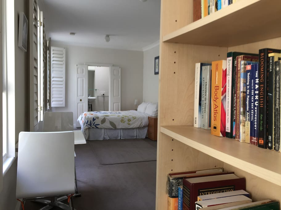 The apartment has its own library of over 150 books