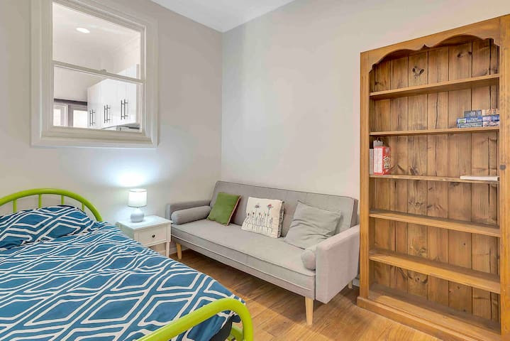 The second bedroom of the property, with a sofa bed and one single bed. Perfect for families wanting to be next door to the beach!