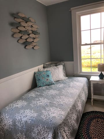 1st floor bedroom with twin bed and a view