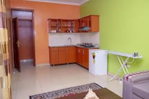 A kitchenette with all the basic amenities.  Washing machine and Iron are also ready. We also have a someone who can take care of your laundry if needed.