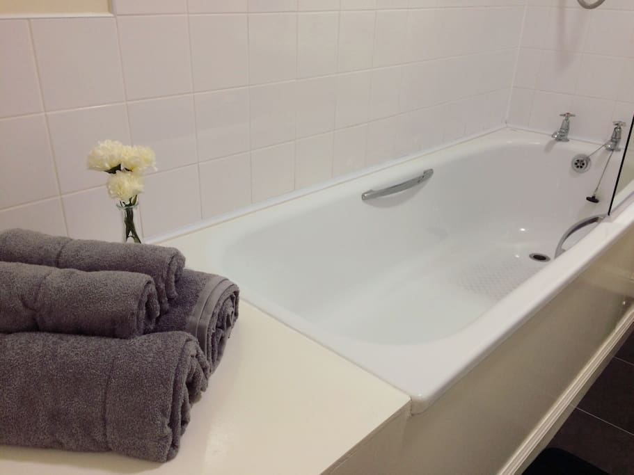Large bath to soak in after a busy day.