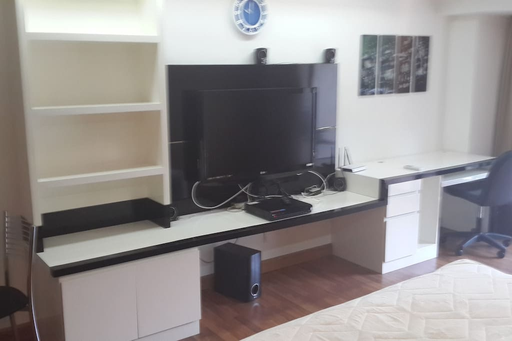 Entertianment center with large screen TV, DVR, Sound system, and Wireless router to connect your internet service