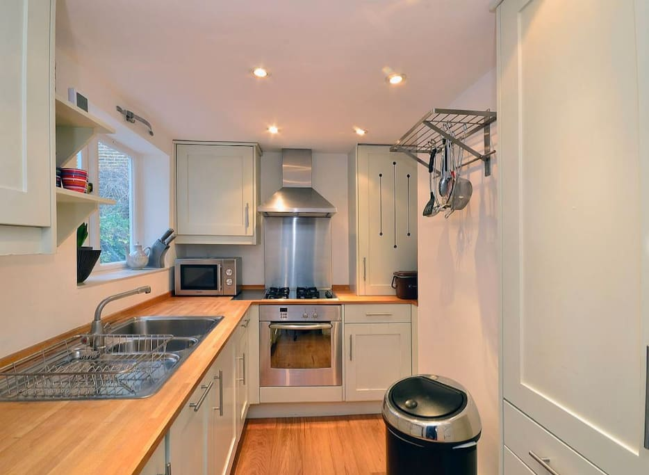 Fully equipped kitchen includes dishwasher.