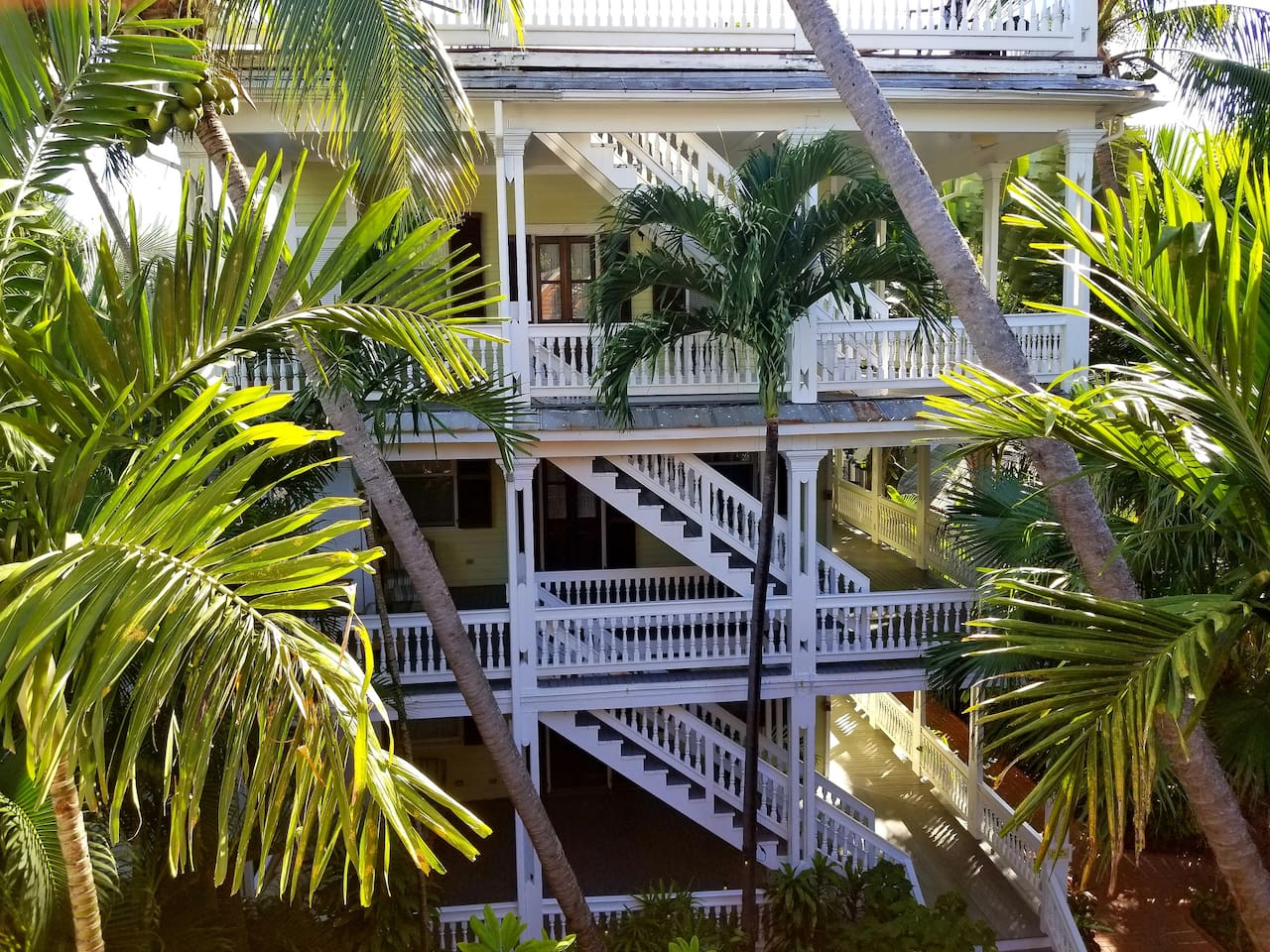The Island Suite is part of a historic Key West property built around 1889. Suite #16 is located on the first floor at the rear of the 411 William Street building.