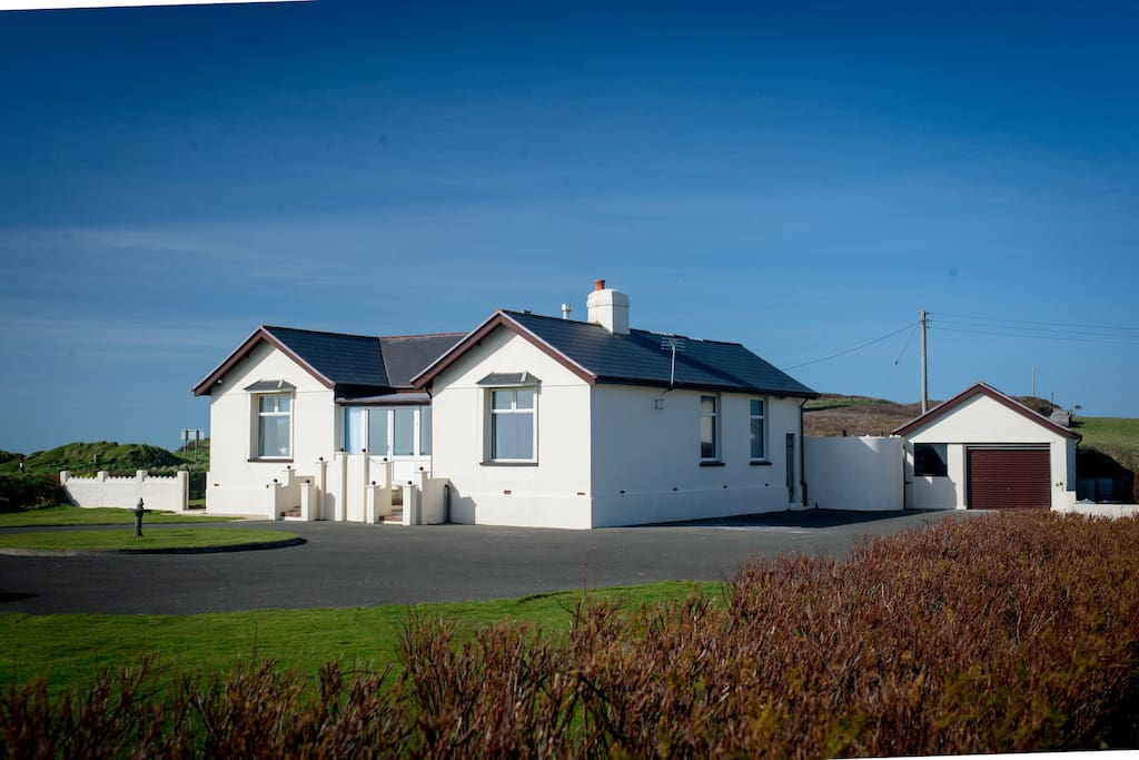 House overlooking the sea and rolling countryside. Lawn for croquet or any other games you desire