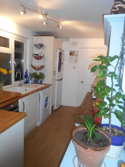 The galley kitchen, small, but has nearly  everything you need with induction hob, oven, fridge/freezer and washing machine